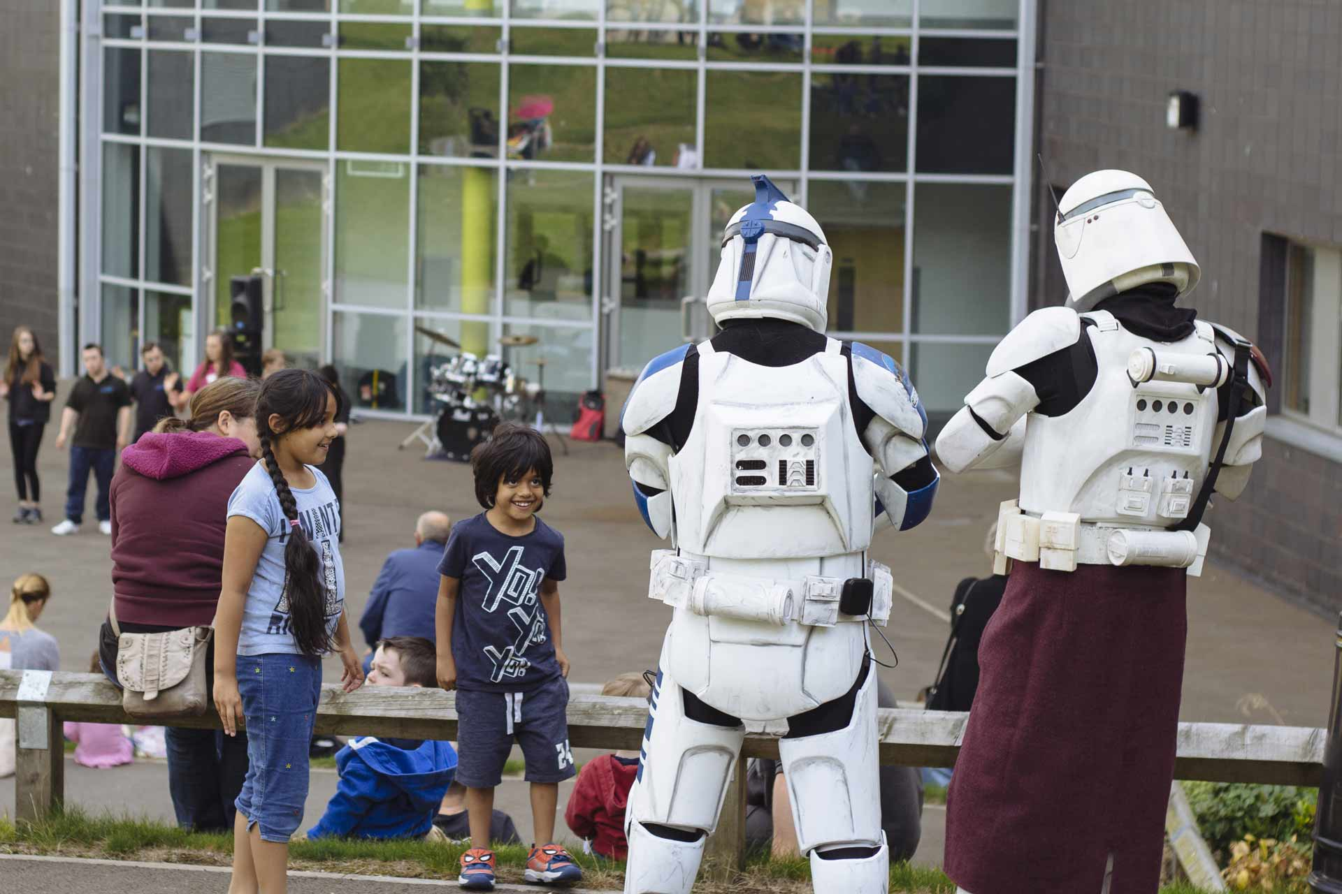 Two children and two Stormtroopers