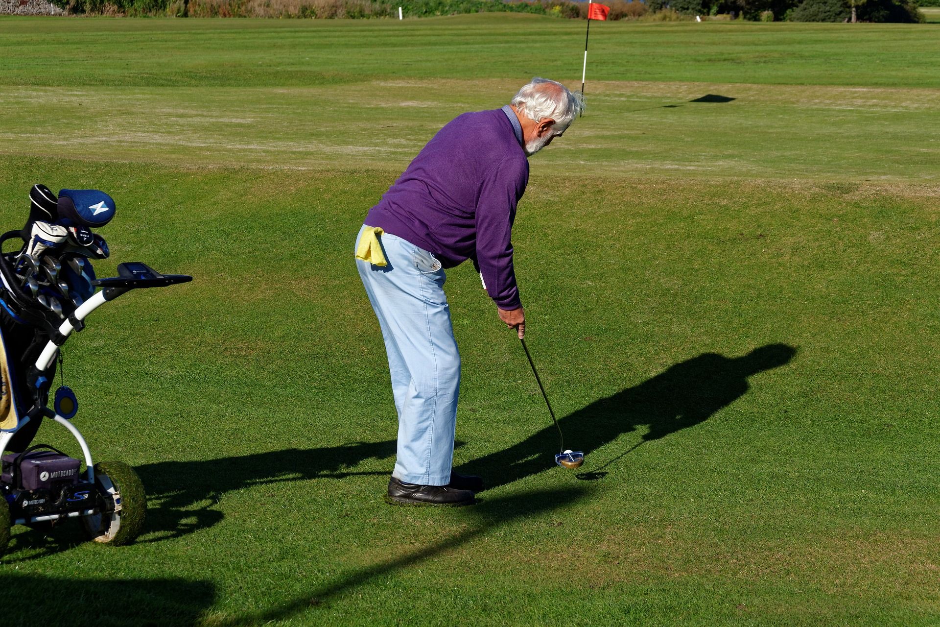 Elderly man playing golf